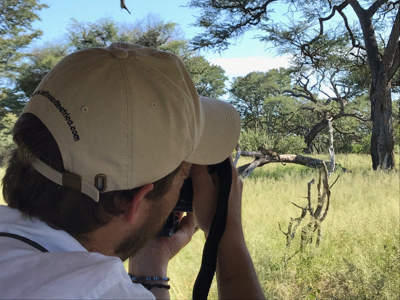Marnus photographing a perfectly posing leopard in Hwange National Park