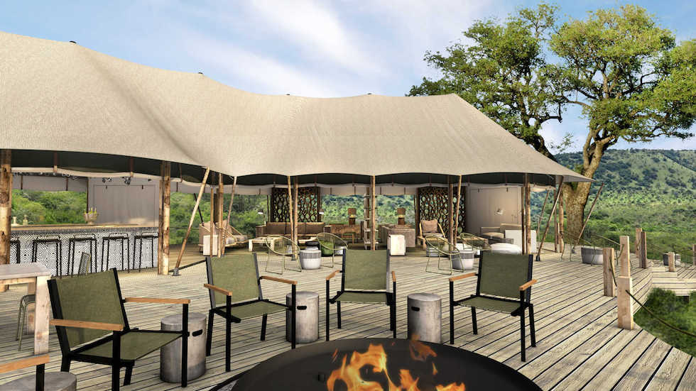 Magashi Camp deck overlooking the lake with open-air fire pit concept